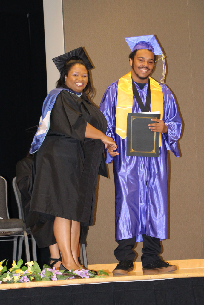 High School Student receiving high school diploma. SIATech Moreno Valley  Charter High School.